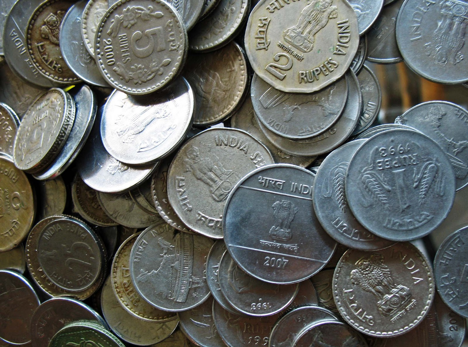 Refusing to accept coins Four traders booked