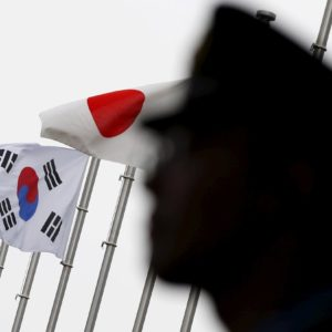 Refile: South Korea warns Japan of security pact risk, calls for 'cooling-off' in trade row